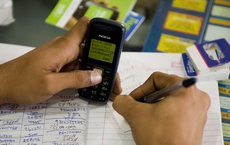11450 milliards de F Cfa de transactions Mobile Money dans la zone CEMAC et UEMOA en 2016 | Crédit photo : MANPREET ROMANA/AFP/Getty Images